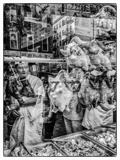 Chinatown deli window reflection