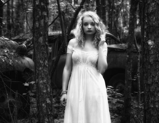 Elizabeth in the woods with rust