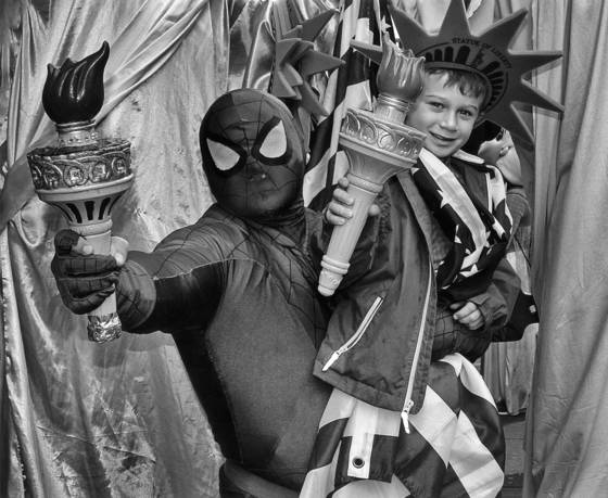 Spiderman and young tourist