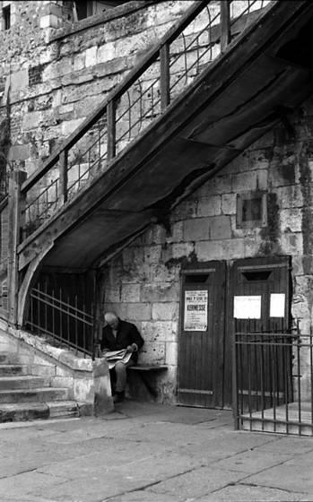 Man under stair