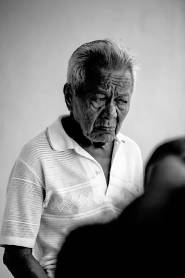 Old man in white shirt