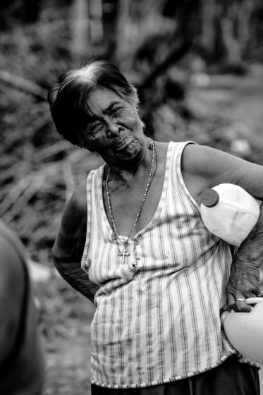 Smiling women carrying milk