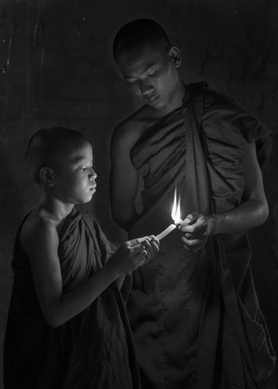 Two monks with candles