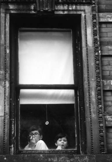 Two boys at bottom of window
