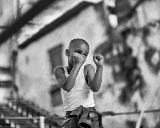 Boy boxing shadows