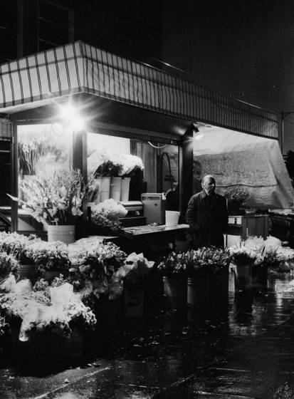 Dispirited flower vendor