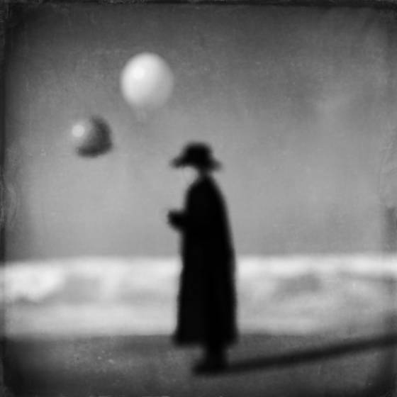 Man in black with balloons  5