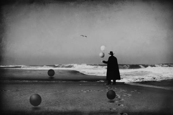 Man in black with balloons and spheres  2