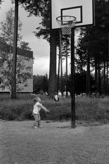 Little girl playing basket
