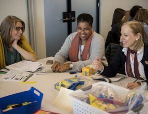Educators work with math manipulatives during an Explore Session.
