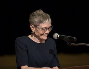 Dean Cecelia Traugh speaks at the podium during the 2019 Alumni Awards