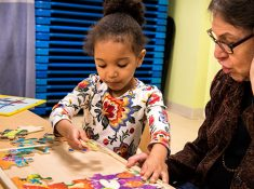 Young girl doing puzzle