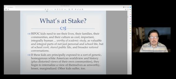 "David Bowles presenting ""What's at Stake?"" slide at virtual Latinx Mini-Conference"