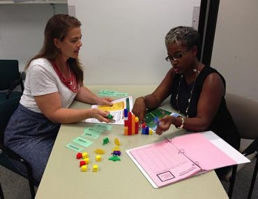 Katherine Baldwin and Erica Buchanan plan a Building Blocks activity