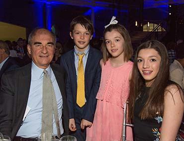 Vincent Mai with three grandchildren