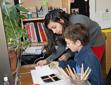 Teacher working with student in a morning class