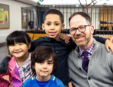Jed Lippard with children in the Bank Street School for Children lobby
