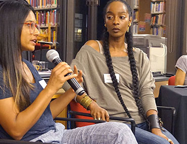 Panelists speaking at the Library Salon