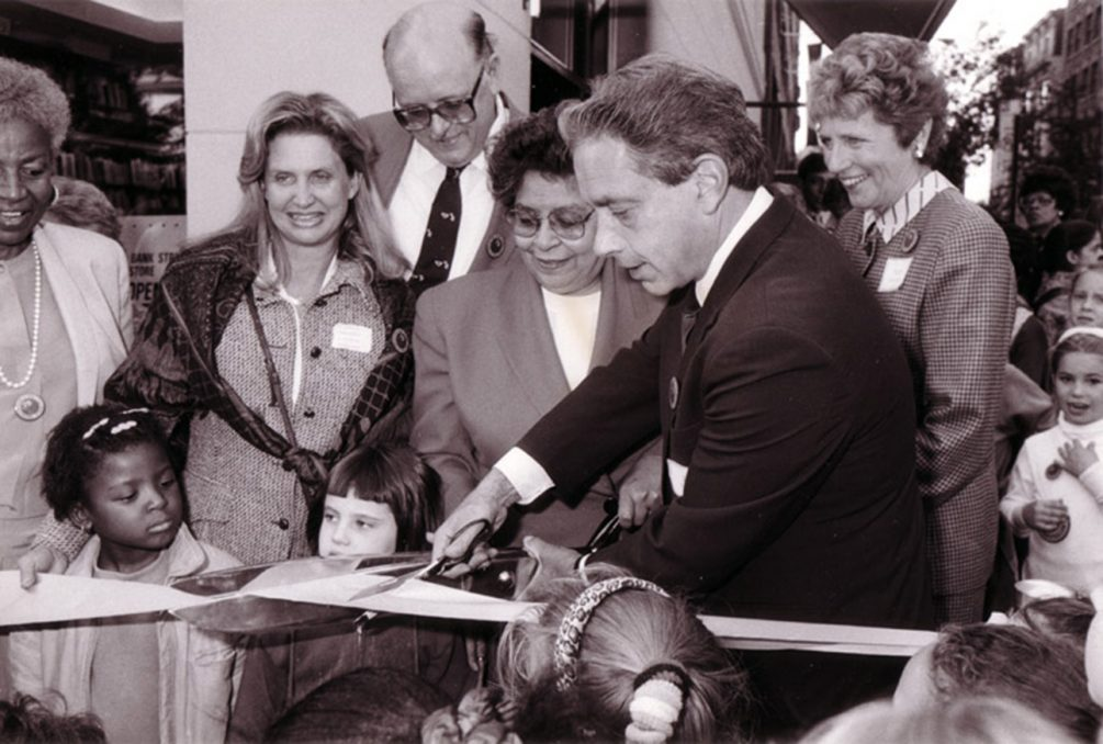 Archival photo of President Shenker cutting the ribbon to open the Bank Street Bookstore, 1990.