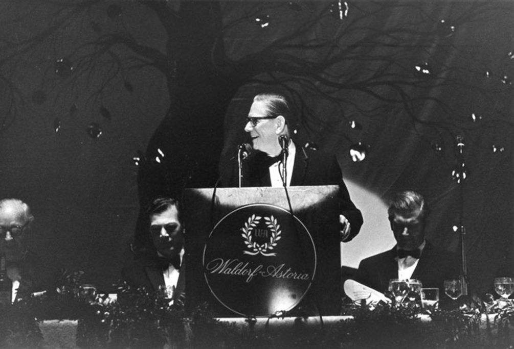 Archival photograph of President Niemeyer speaking from lectern at the Humanities Award Dinner, 1969.