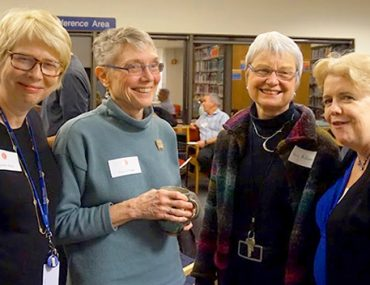 Cynthia Weill, Director of the Center for Children's Literature; Dean Cecelia Traugh; Graduate School faculty members Nancy McKeever and Peggy McNamara at the Library Salon.