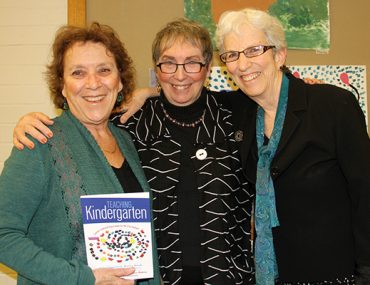 Bank Street Hosts Book Launch for 'Teaching Kindergarten' Posted by Bank Street on December 02, 2015 On December 1, President Shael Polakow-Suransky and Graduate School Dean Cecelia Traugh joined more than a hundred alumni, faculty, and friends to celebrate the launch of the new book Teaching Kindergarten: Learner-Centered Classrooms for the 21st Century. Published by Teacher's College Press, the book was edited by Bank Street alumni Julie Diamond '73, Betsy Grob '72 and '98, and Fretta Reitzes '69 and includes chapters written by progressive practitioners Hollee Freeman '94, Margaret Blachly '05, Rebecca Burdett '99, and Andrea Fonseca '03. Betsy Grob, Fretta Reitzes, and Julie Diamond with their book Teaching Kindergarten.
