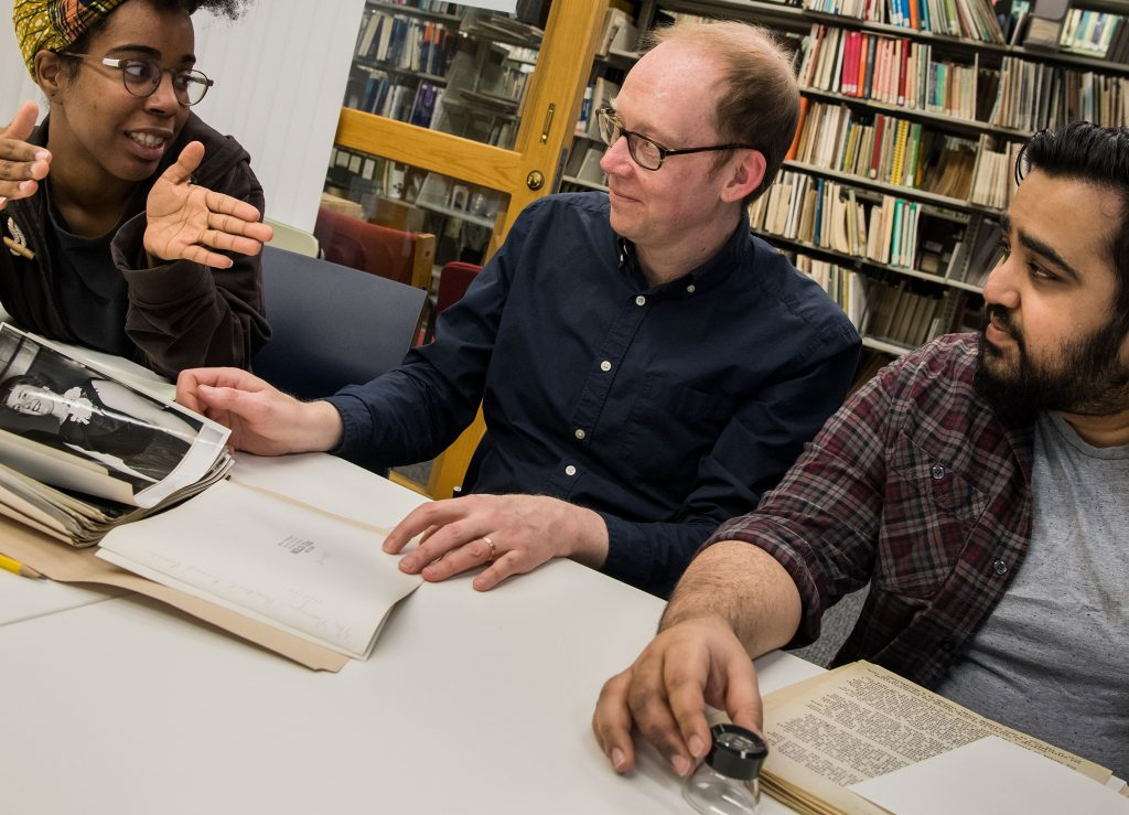Researchers with Archivist at Library