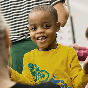 Boy smiling in playgroup