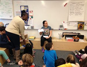 Teacher leading discussion in classroom