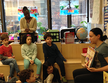Teacher showing books to students
