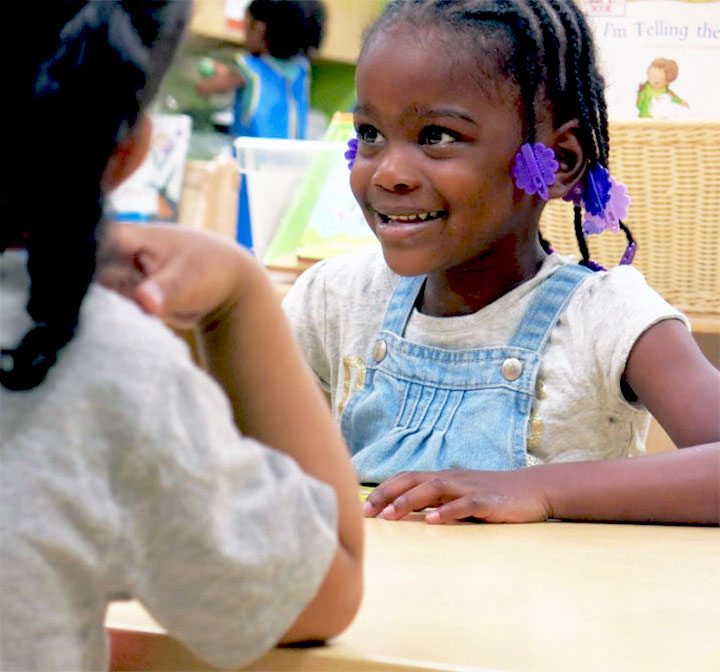 Girl smiling at Head Start