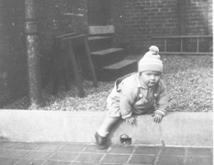 Archival image of young child outside