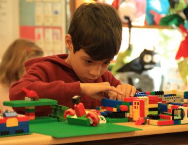 Child playing legos