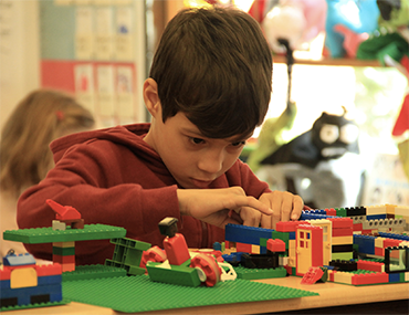 Child building with legos