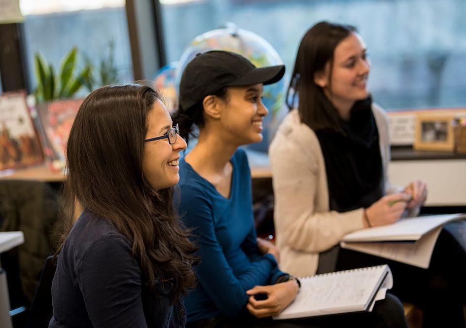 Three graduate students in classroom