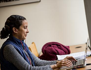 Graduate student on laptop