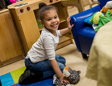 Head Start student playing in a classroom