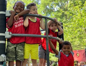 Four Head Start students on the playground
