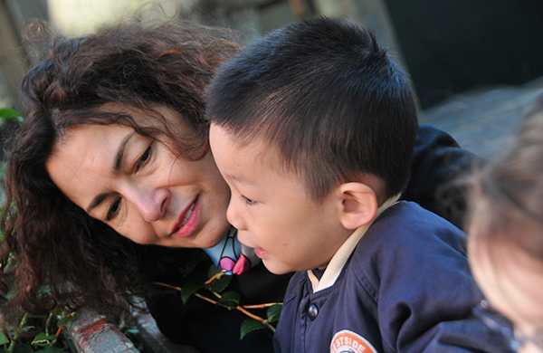 A teacher and young child