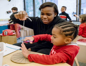 Teacher and child make art
