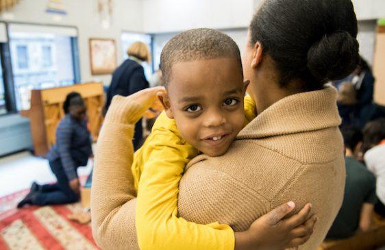 Adult holding smiling child