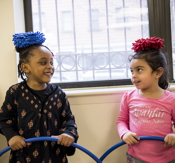 Two children holding hula hoops