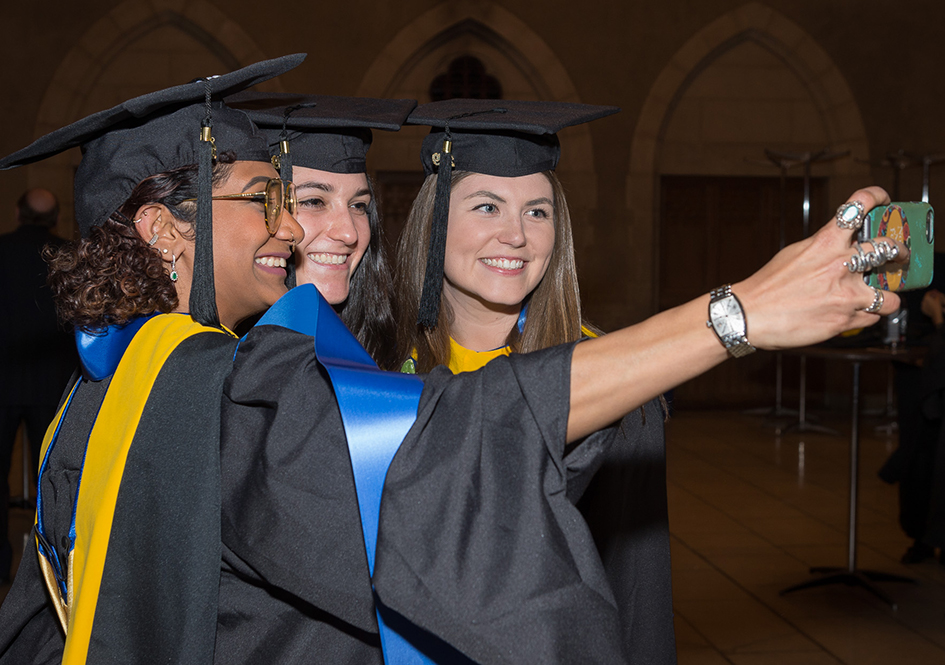 Graduates taking a selfie