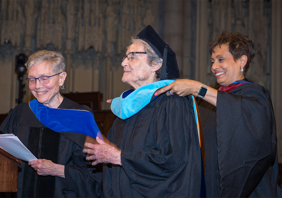 Conferral of the honorary degree to Eleanor Duckworth - Dean Traugh on stage with Eleanor Duckworth and Yolanda Ferrell-Brown