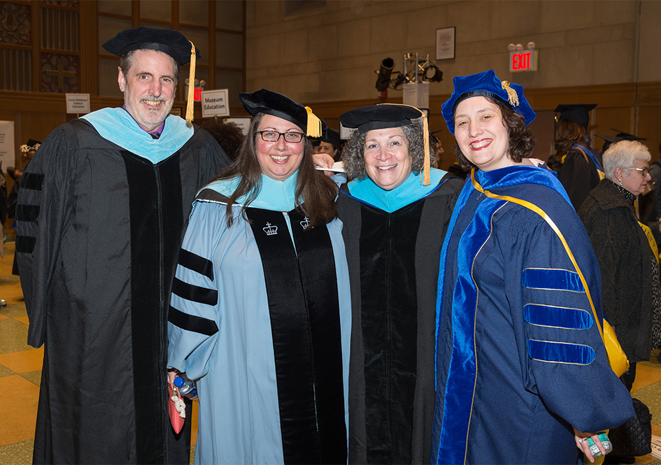 Four Graduate School faculty members at commencement