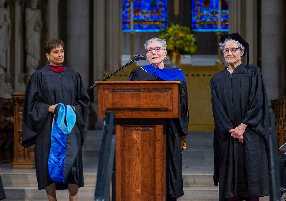 Conferral of the honorary degree - Yolanda Ferrell-Brown, Dean Traugh, and Eleanor Duckworth on stage