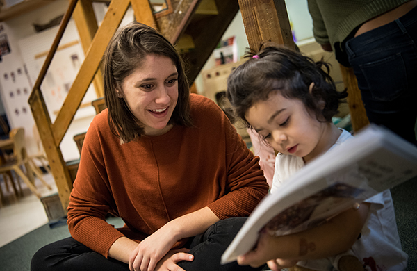 Graduate student reading with a child