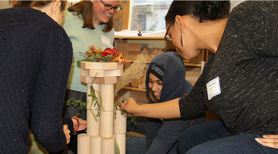 Four participants building with blocks