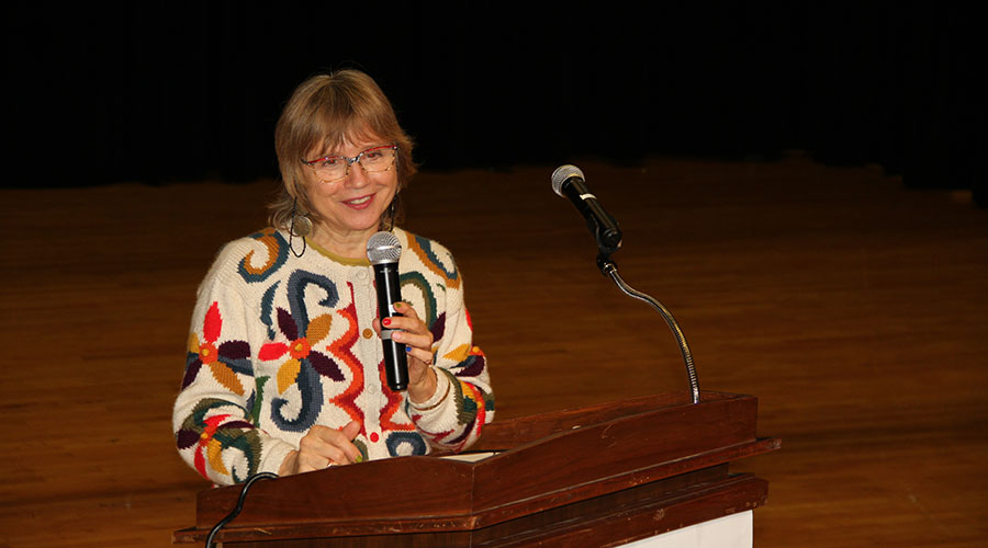 Luisa Costa speaking in the auditorium