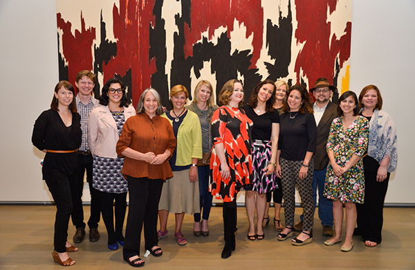 Leadership in Museum Education students posing in front of a Clyfford Still artwork